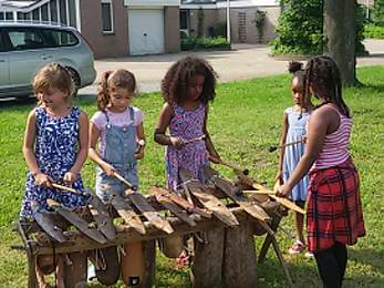 Children play balafon